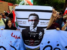 """Photo credit the Lebanese newspaper Al Akhbar: """"In Bas Riad the thief. Down with the reign of the Dollar """". Banner of Lebanese demonstrators Thursday, October 24, 2019 scolding Riad Salameh, governor of the Bank of Lebanon. """"Riad, the thief"""". Down with the reign of the Lebanese Central Bank and Lebanon will be reborn"""
