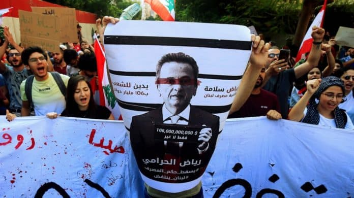 "Photo credit the Lebanese newspaper Al Akhbar: ""In Bas Riad the thief. Down with the reign of the Dollar "". Banner of Lebanese demonstrators Thursday, October 24, 2019 scolding Riad Salameh, governor of the Bank of Lebanon."