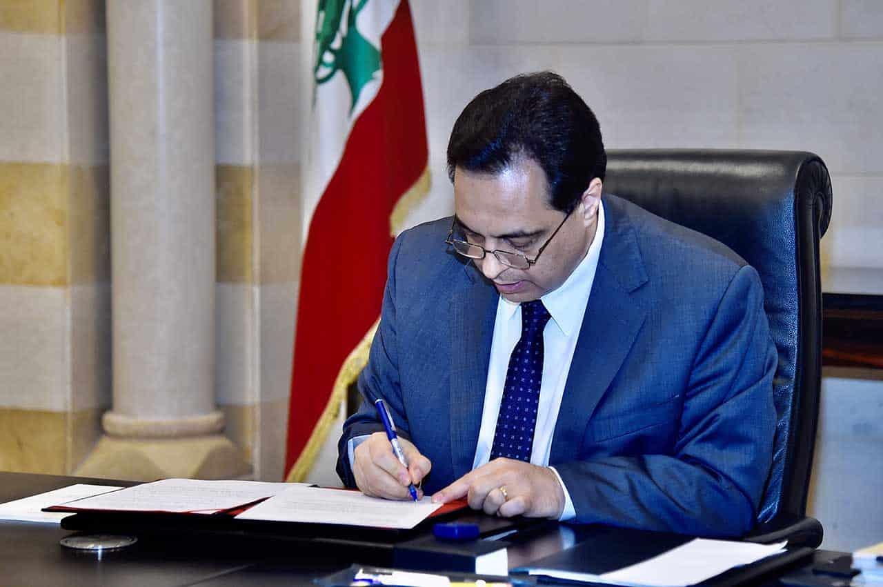 Le Premier Ministre Hassan Diab officialisant la demande d'aide économique du Liban au FMI. Crédit Photo: Dalati & Nohra